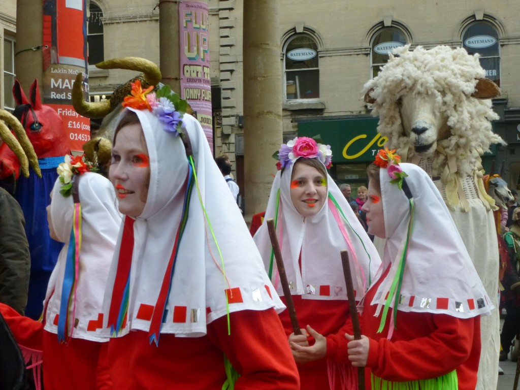 Colourful local women's morris side Boss seem unaware that the Cotswold lion is pursuing them. (Photo (c) Dennis Kelly)