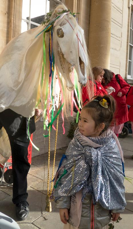 The Mari Lwyd makes friends with a youngster. (Photo (c) Deborah Roberts)