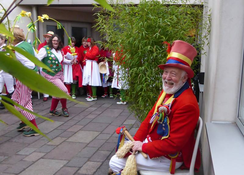 Robin from the Gloucestershire Morris Men enjoys a rest while watching Clocs Canton. (Photo (c) Deborah Roberts)